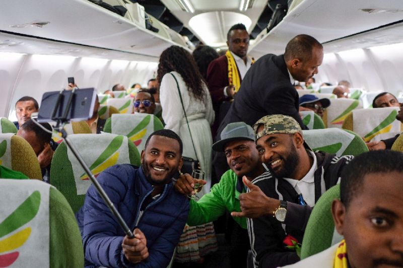 Passengers pose for a selfie aboard the Ethiopian Airlines plane -- the first flight from Addis Ababa to Eritrea in a generation (AFP Photo/Maheder HAILESELASSIE TADESE)