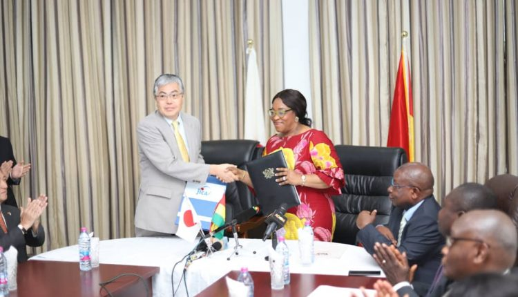 Ministers of both countries in a handshake after the signing ceremony