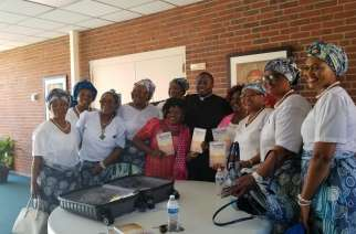 Father Wilfred Emeh  with Catholic Women  Association members after a recent event to launch the book in the USA