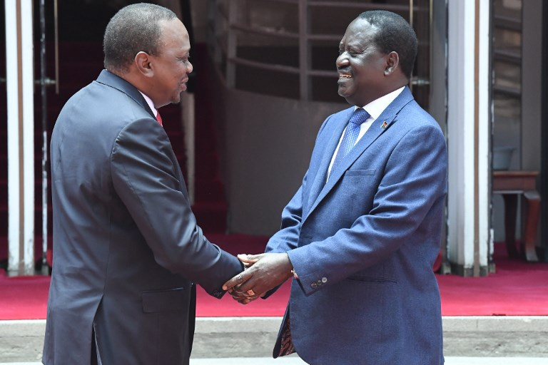 It was a handshake that drew a line under Kenya's bruising election, left many people bewildered and swung open the starting gate for the 2022 presidential race, AFP reports on April 10, 2018. / AFP PHOTO / SIMON MAINA