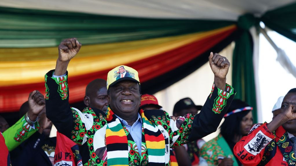 FILE - Zimbabwe's President Emmerson Mnangagwa addresses a rally in Bulawayo, June 23, 2018.