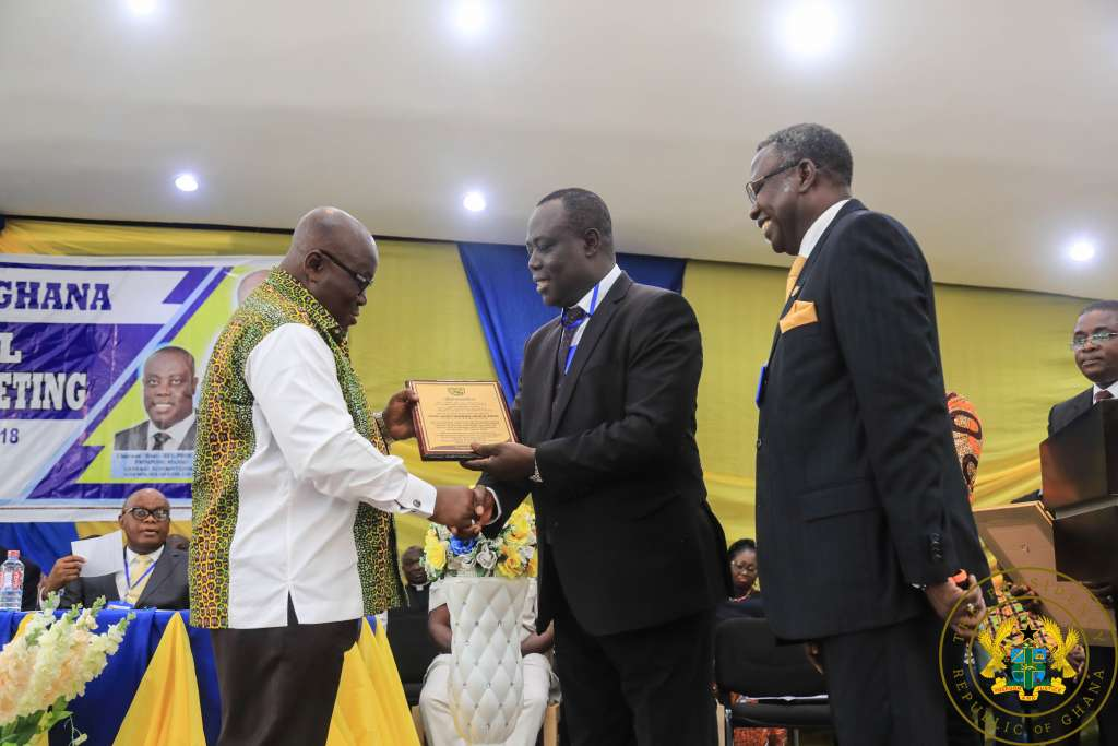 President Akufo Addo receiving a citation from Rev Dr.-Paul Frimpong Manso General Superintendent of the Assemblies of God Church.