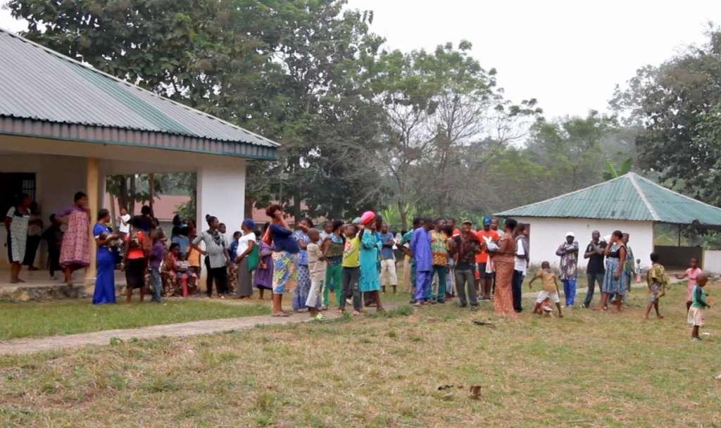 A still image taken from a video shot on December 9, 2017 shows Cameroonian refugees standing outside a center in Agbokim Waterfalls village, which borders on Cameroon, Nigeria. REUTERS/via Reuters TV