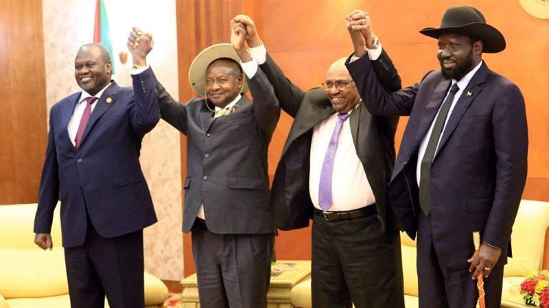 File Picture.Sudan's President Omar Al-Bashir hold hands with Uganda's Yoweri Museveni, South Sudan's Salva Kiir and rebel leader Riek Machar during a peace meeting in Khartoum as part of talks to negotiate an end to a civil war that broke out in 2013, June 25, 2018. /REUTERS