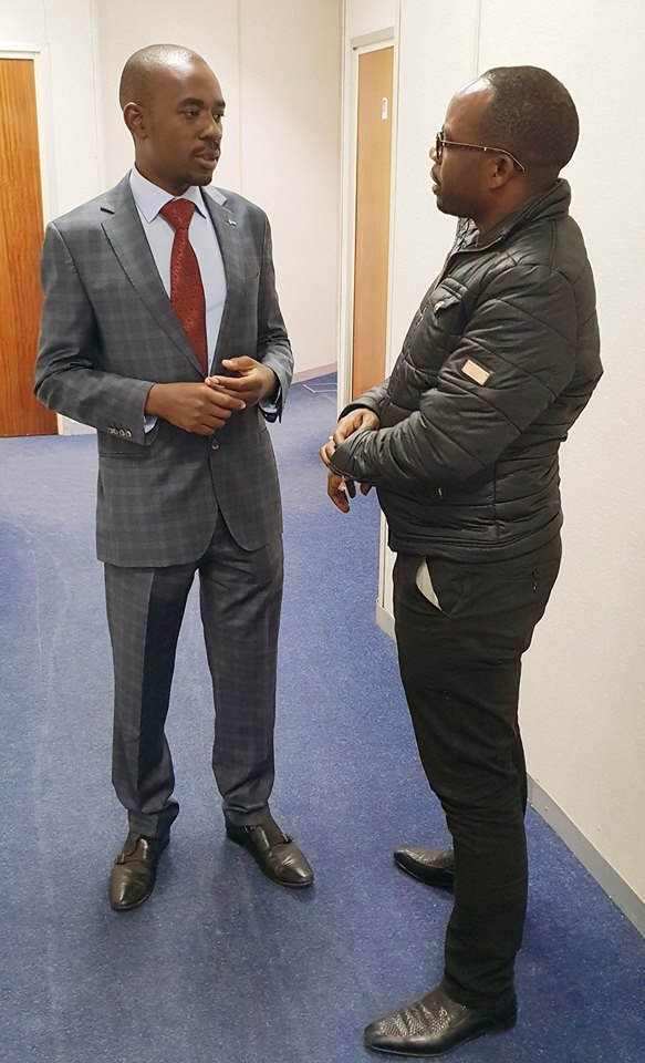 Silas pictured here with MDC's Nelson Chamisa says he left Zimbabwe before the eruption of violence