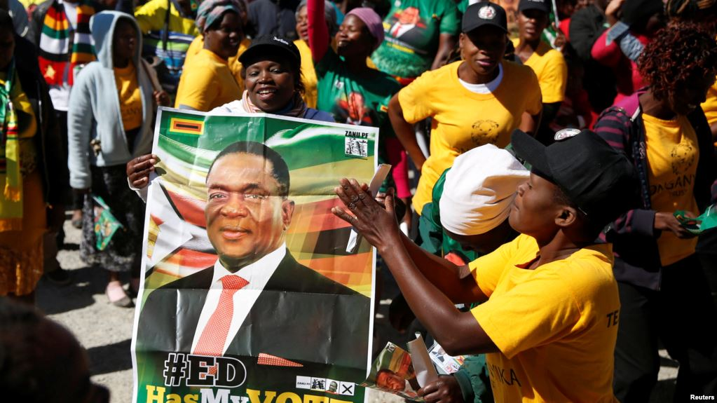 Supporters of President Emmerson Mnangagwa's ZANU PF party gather to march for non-violent, free and fair general elections in Harare, Zimbabwe, June 6, 2018.