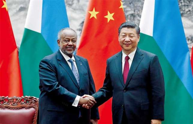 Chinese President Xi Jinping shakes hands with Djibouti's President Ismail Omar Guelleh