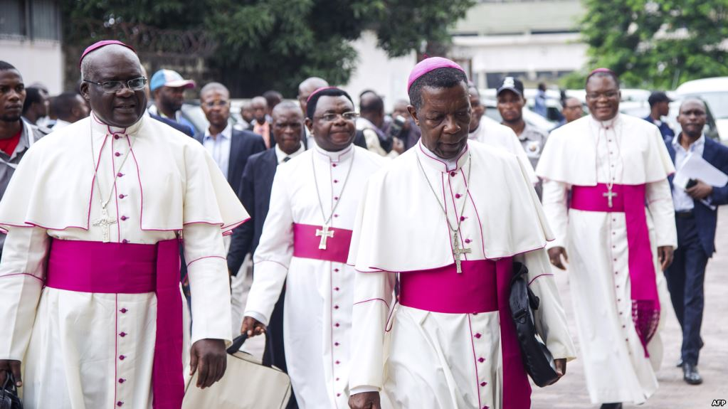 FILE - Archbishop Marcel Utembi, second left, president of the National Episcopal Conference of Congo (CENCO), and other Catholic bishops arrive for the signing of an accord at the interdiocesan center in Kinshasa, Jan. 1, 2017 following talks launched by the Roman Catholic Church between the government and opposition.