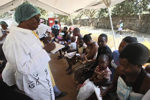 A health worker screens mothers and their babies suspected to have cholera in a quarantined area in Harare on Friday. A state of emergency has been declared declared in Zimbabwe's capital after the death of at least 30 people from cholera. People in Harare feara repeat of the cholera outbreak that killed thousands of people in in 2008. Picture: AP/African News Agency