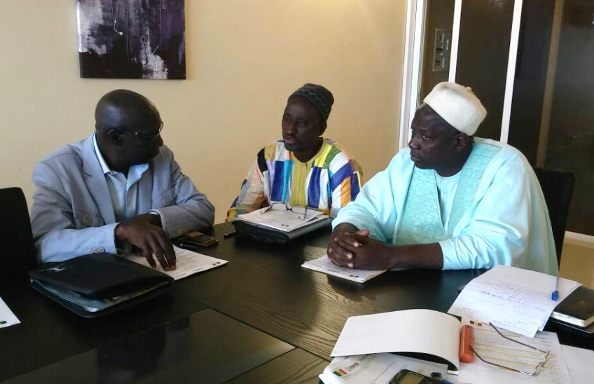 Moctar Fofana, WARMA Vice President (left), Mamour Gueye, Second Vice-President IAMS (center), and Mafouze Aidara, IAMS President (right) discuss details of the upcoming General Assembly meeting. Photo credit/Africa Lead