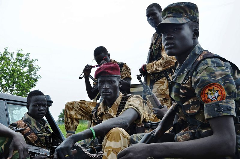South Sudanese SPLA soldiers are pictured in Pageri in Eastern Equatoria state on August 20, 2015. Photographer: Samir Bol/AFP/Getty Images