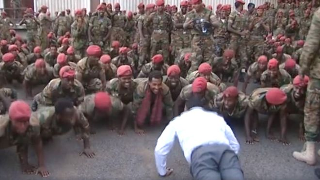 The smiles on the soldiers' faces suggest the prime minister succeeded in defusing the situation amicably