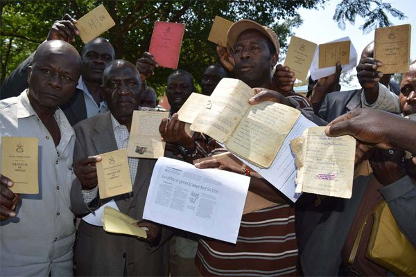 Former Kenya Air Force soldiers display their discharge certificates after a press briefing in Kisumu on June 22, 2017. PHOTO | ONDARI OGEGA | NATION MEDIA GROUP