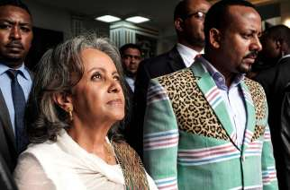 Sahle-Work Zewde walks with Prime Minister Abiy Ahmed after being elected as Ethiopia's first female President at the Parliament in Addis Ababa on Oct. 25, 2018.Eduardo Soteras / AFP - Getty Images