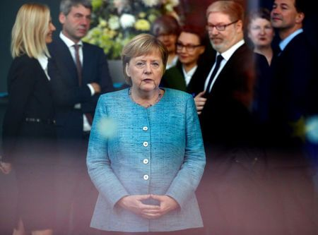 German Chancellor Angela Merkel waits for Ethiopian Prime Minister Abiy Ahmed to arrive at the Chancellery in Berlin, Germany, October 30, 2018. REUTERS/Hannibal Hanschke