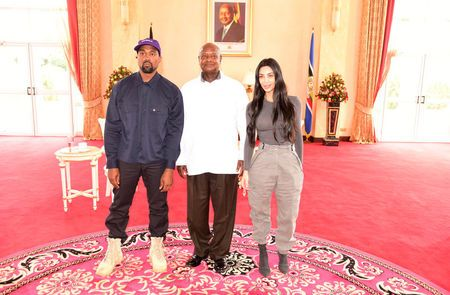Rapper Kanye West (L) and Kim Kardashian (R) pose for a photograph with Uganda's President Yoweri Museveni when they paid a courtesy call at State House, Entebbe, Uganda October 15, 2018. Presidential Press Unit/Handout via REUTERS