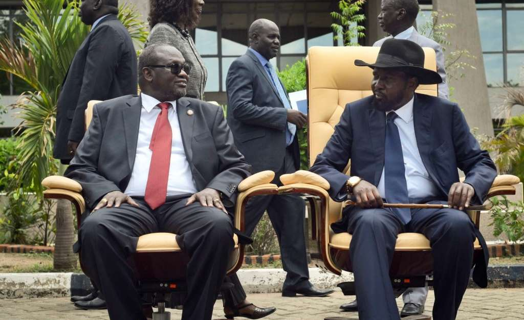 South Sudan's then-first vice president, Riek Machar, left, and President Salva Kiir sit to be photographed after the first meeting of a new transitional coalition government in the capital, Juba, in April 2016. (Jason Patinkin/AP)