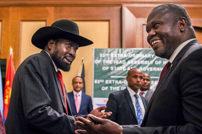 South Sudan's President Salva Kiir and opposition leader Riek Machar shake hands