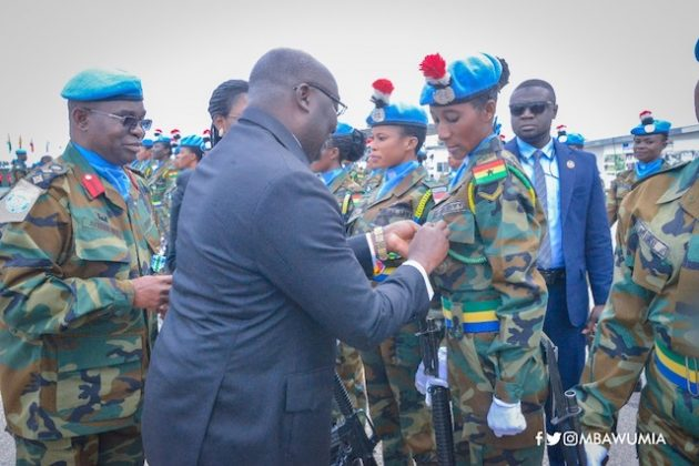Dr Bawumia pinning medals at a colourful ceremony