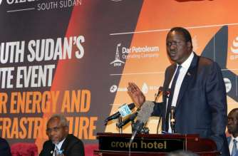 South Sudan's petroleum minister Ezekiel Gatkuoth welcomes potential investors during the second Africa Oil and Power conference in Juba. AP
