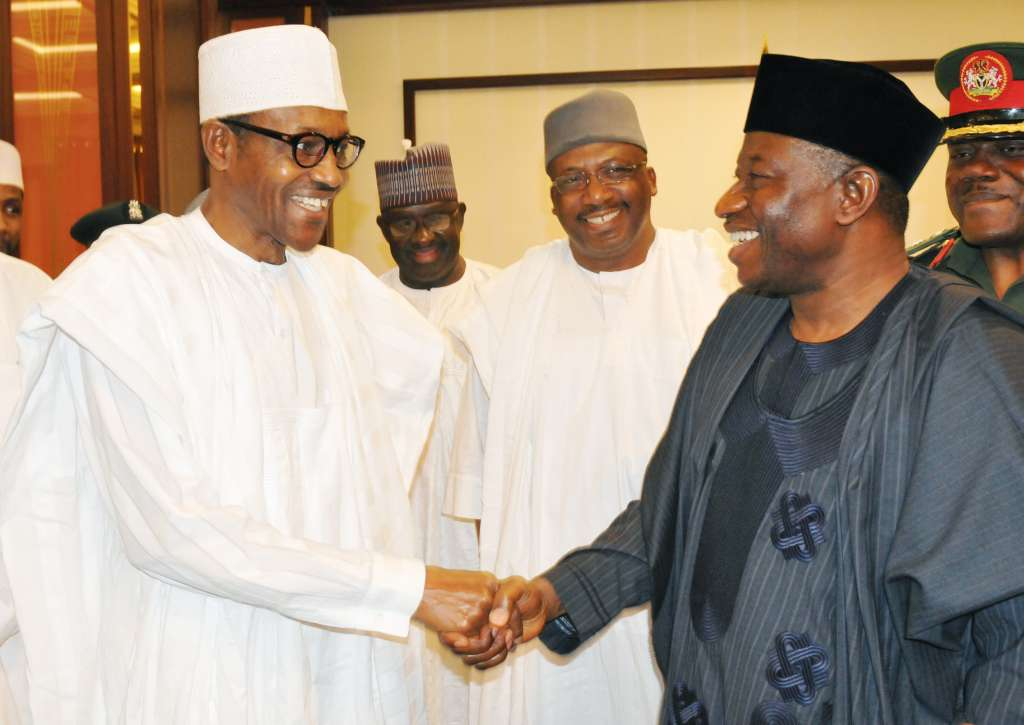 File picture.President-Elect Retired Maj.-Gen. Muhammadu Buhari (L) In A Handshake With President Goodluck Jonathan During His Official Visit To The Presidential Villa In AbujaOn Friday (24/4/15).With Them Is The Former Chief Of Army Staff,Retired Lt.-Gen. Abduhraman Dambazau