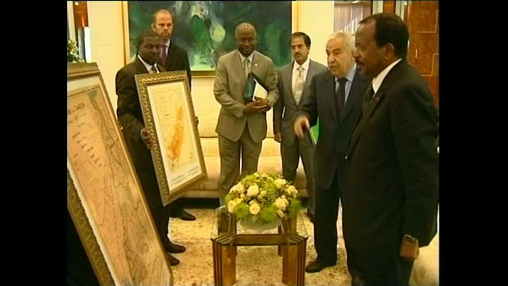 History Lesson: 64th President of the UN General Assembly Ali Triki presents President Biya with two maps of La Republique du Cameroun and Southern Cameroons in an audience during festivities to mark the 50th independence anniversary of Cameroun