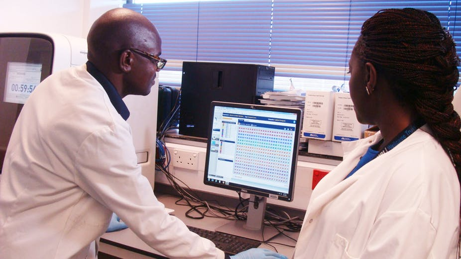 Scientists analysing data at the South-South Malaria Research Partnership project laboratory in Kenya. Flora Mutere-Okuku