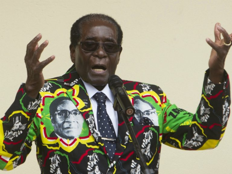 In this Dec. 17, 2016, file photo, Zimbabwean President Robert Mugabe addresses people at an event before the closure of his party's 16th Annual People's Conference in Masvingo, south of the capital, Harare. (AP Photo/Tsvangirayi Mukwazhi, File)