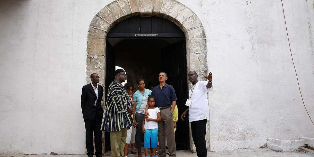 """U.S. president Barack Obama, Michelle Obama and their daughters Malia and Sasha stand at the """"Door of No Return"""" during their visit to the Cape Coast Castle, Ghana, July 11, 2009."""