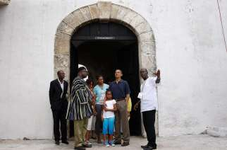 "U.S. president Barack Obama, Michelle Obama and their daughters Malia and Sasha stand at the ""Door of No Return"" during their visit to the Cape Coast Castle, Ghana, July 11, 2009."