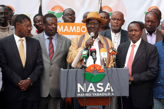 File Picture.Nasa leader Raila Odinga with other leaders of the opposition alliance addresses a press conference at the OKOA Kenya secretariat in Lavington, Nairobi. PHOTO | DENNIS ONSONGO