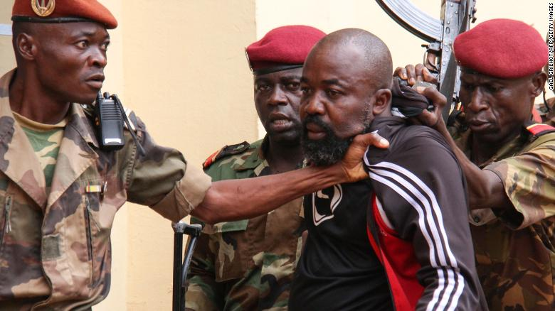 Yekatom (center) is arrested by members of the armed forces on October 29, before being handed over to the International Criminal Court.