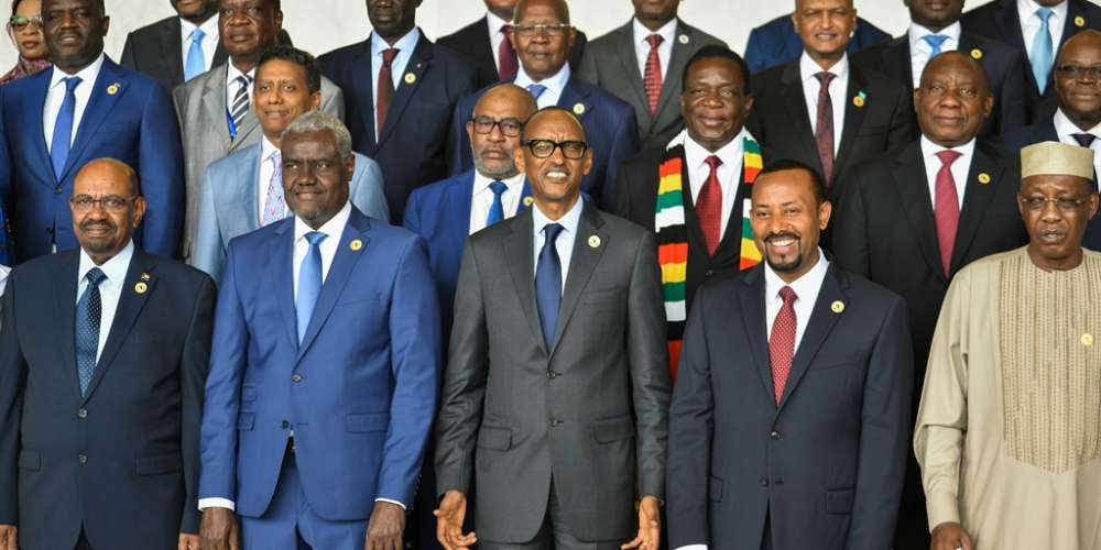 Africa Union Commission Chairperson, Moussa Faki Mahamat (2ndL front row) poses for a family photo with Africa's Presidents (fromL) Sudan's Omar al-Bashir, Rwanda's Paul Kagame, Ethiopia's Prime Minister Abiy Ahamed and Chad's Idris Deby, on the sidelines of an AU summit in Addis Ababa, Ethiopia. (AFP)