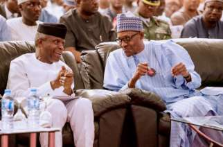 Buhari and running mate Osinbajo at the launch of the campaign-manual