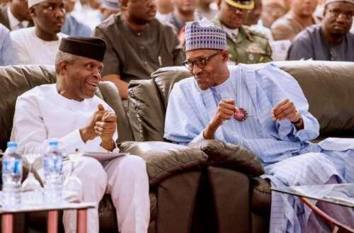 Buhari and running mate Osinbajo at the launch of the campaign-manual