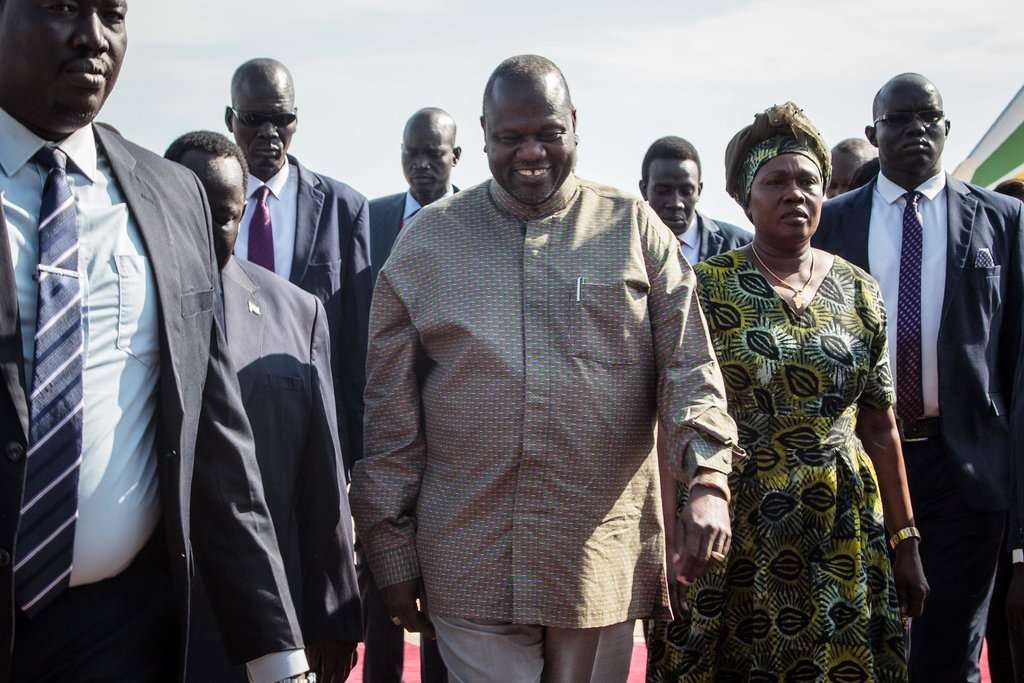 """We need peace,"" said Riek Machar, center, after arriving in Juba, South Sudan, on Wednesday.CreditCreditAkuot Chol/Agence France-Presse — Getty Images By Reuters"