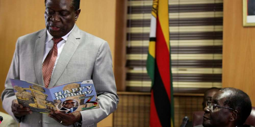 FILE PHOTO: Zimbabwe's President Robert Mugabe looks on as his deputy Emmerson Mnangagwa reads a card during Mugabe's 93rd birthday celebrations in Harare, Zimbabwe, February 21, 2017. REUTERS/Philimon Bulawayo/File Photo