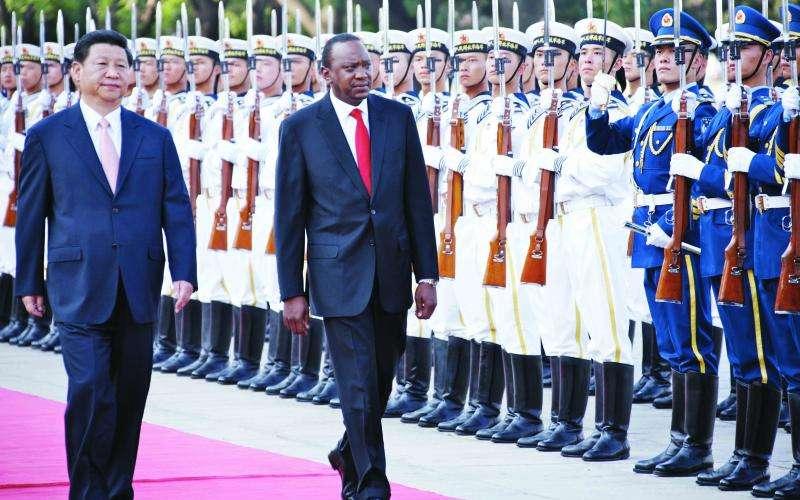 President Uhuru Kenyatta and his Chinese counterpart Xi Jinping inspect a guard of honour during Uhuru's visit to Beijing in 2015.