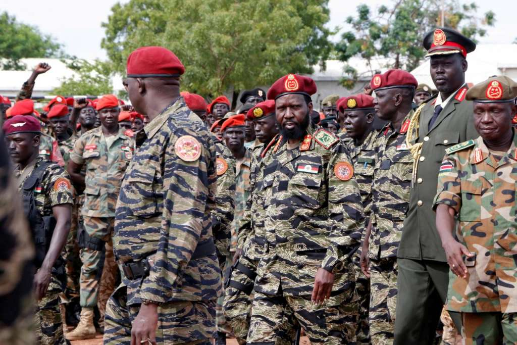 FILE PHOTO: South Sudan's President Salva Kiir (C) attends a ceremony marking the thirty fourth anniversary of the Sudan People's Liberation Army (SPLA) at the military headquarters in Juba, South Sudan May 18, 2017. REUTERS/Jok Solomun/File Photo
