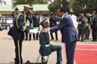 President Paul Biya decorates a security officer during the 36th graduation ceremony of EMIA 36 promotion-EMIA