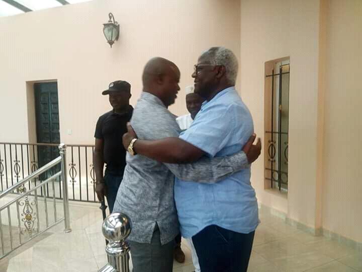 Sierra Leone's former VP, Sam-Sumana (L), hugs his former boss, ex-President Ernest Bai Koroma