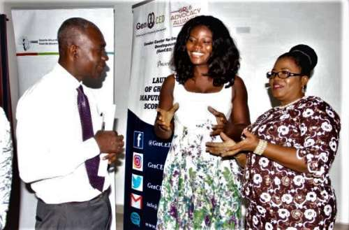 Mrs Comfort Asare (right), Director, Department of Gender, interacting with Ms Esther Tawiah (2nd left), the Executive Director, GenCed and Mr Frank Bodza, Programme Manager, WiLDAF Ghana. Picture: Maxwell Ocloo,Graphic Online