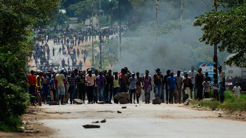 Angry protesters barricade the main route to Harare, the capital of Zimbabwe, after the government more than doubled gas prices. (JEKESAI NJIKIZANA / AFP/Getty Images)