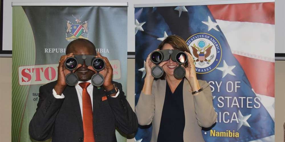 Honorable Minister Pohamba Shifeta and U.S. Ambassador Lisa Johnson try out some of the 65 pairs of low light binoculars donated in support of the Ministry of Environment and Tourism's anti-poaching efforts, 11-Feb-2019.