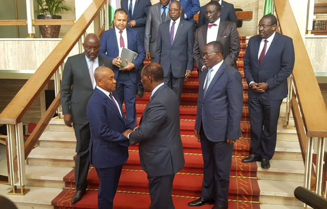 CAF President Ahmad Ahmad with Alassane Ouattara of Ivory Coast during a recent visit