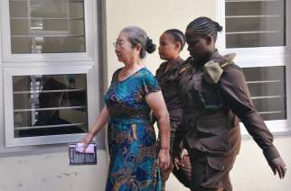 Chinese businesswoman Yang Feng Glan is escorted at the Kisutu Resident Magistrate's Court in Dar es Salaam, Tanzania. Reuters