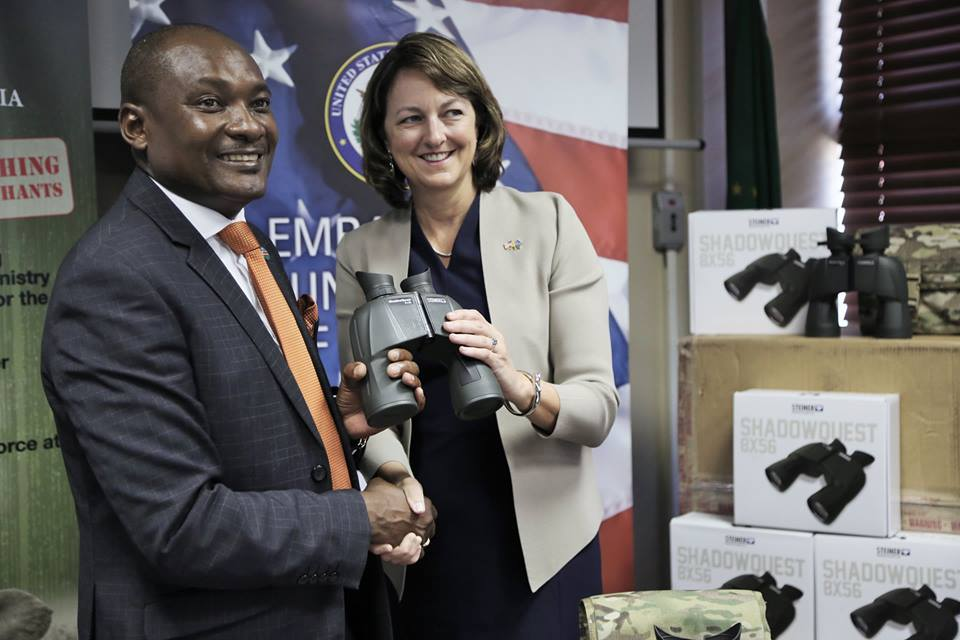 Honorable Minister Pohamba Shifeta accepting the official handover from U.S. Ambassador Lisa Johnson of 65 pairs of low light binoculars donated in support of the Ministry of Environment and Tourism's anti-poaching efforts, 11-Feb-2019.