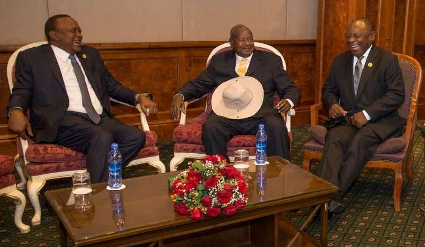 Presidents Uhuru Kenyatta, Yoweri Museveni and Cyril Ramaphosa share a light-hearted moment during the 32nd Summit of the African Union Heads of State and Government in Addis Ababa.