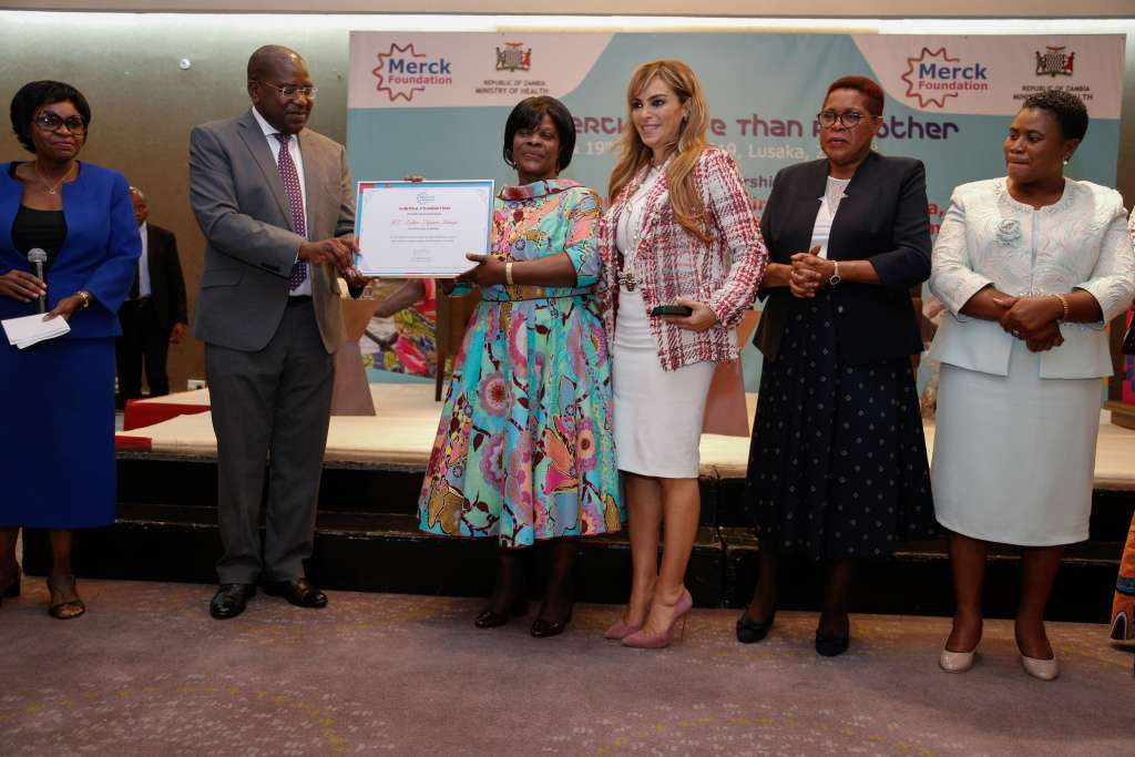 Dr. Rasha Kelej, CEO of Merck Foundation and President, Merck More Than a Mother presenting the award to The First Lady of Zambia, H.E. ESTHER LUNGU for acknowledge her efforts as 'Merck More than a Mother' Ambassador