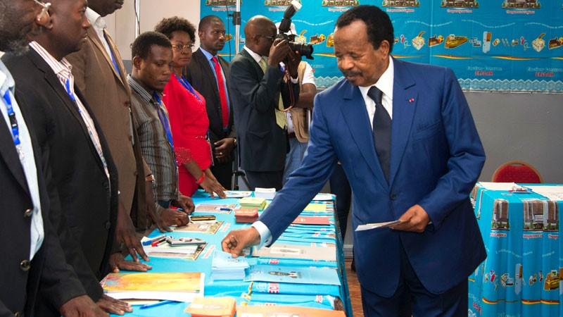 Then incumbent President Paul Biya preparing to cast his vote